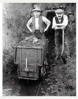Miners with a tub of raw culm at Chapel Park Mine, North Devon